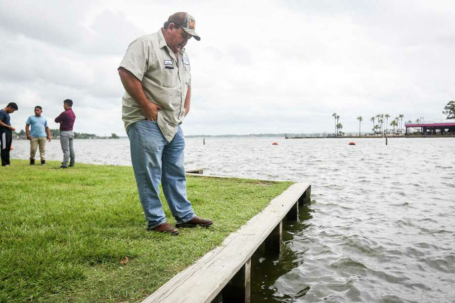 Poncho Viniarski, with Montgomery County Precinct 1 Commissioner's Office, describes on Tuesday, June 19, 2018, damage that the bulkheads of Lake Conroe Park received during storms in the prior weeks. Nails that had been jutting from the wooden bulkhead were removed by the Commissioner's Office. Photo: Michael Minasi, Staff Photographer / Houston Chronicle / © 2018 Houston Chronicle