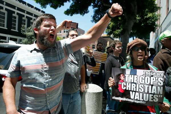 Charles Verrey (left) joins a demonstration in front of the Immigration and Customs Enforcement field office in San Francisco, Calif. on Tuesday, June 19, 2018 to protest the Trump administration's zero tolerance immigration policy.