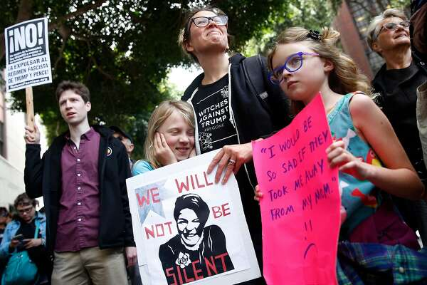 Kate Schatz brought her daughter Ivy Pontius (left), 9, and her friend Annea Berggren-Briggs, 9, to a demonstration in front of the Immigration and Customs Enforcement field office in San Francisco, Calif. on Tuesday, June 19, 2018 to protest the Trump administration's zero tolerance immigration policy.