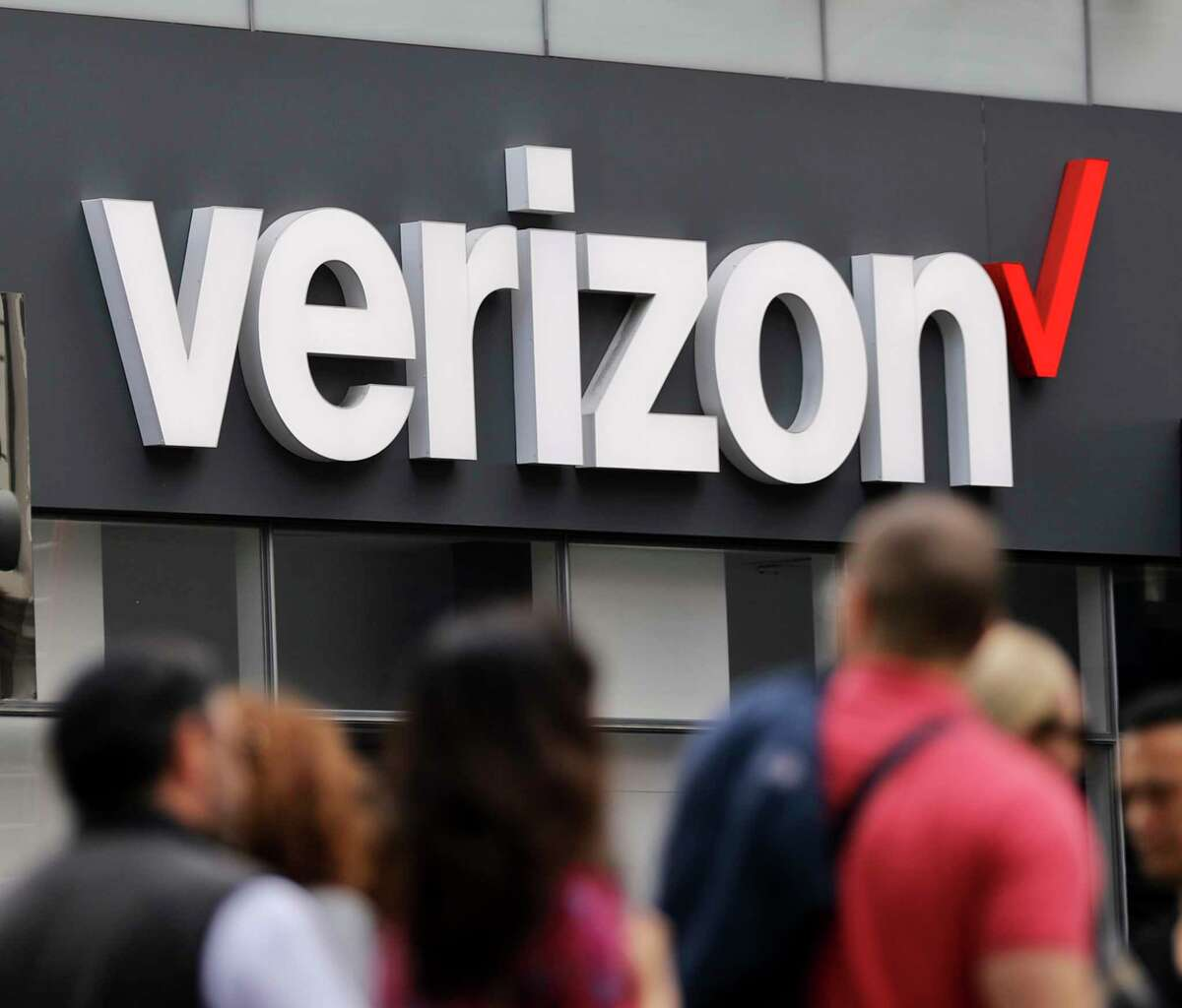 FILE- In this Tuesday, May 2, 2017, file photo, Verizon corporate signage is captured on a store in Manhattan's Midtown area, in New York. Verizon is pledging to stop selling data to outsiders through middlemen that can pinpoint the location of mobile phones, the Associated Press has learned. (AP Photo/Bebeto Matthews, File)