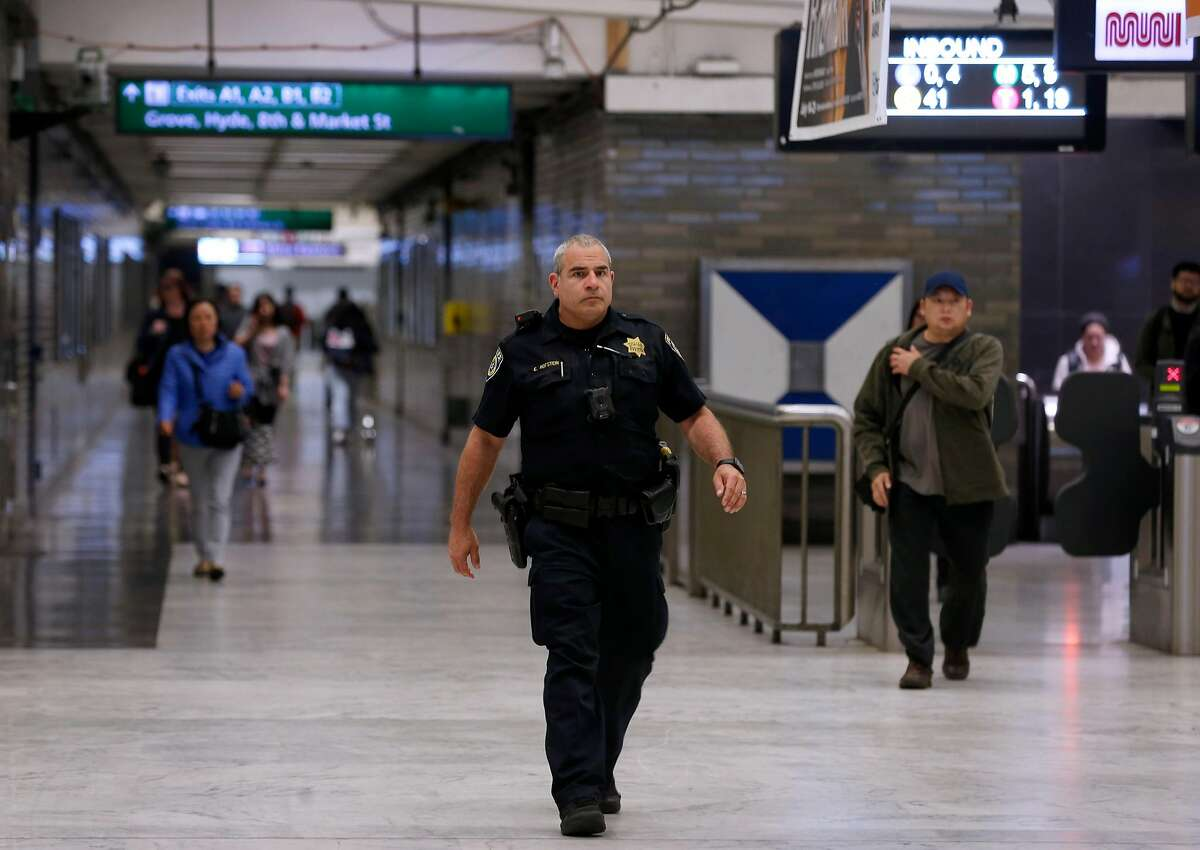 A BART police officer walks through the Civic Center station in San Francisco, Calif. on Tuesday, June 19, 2018. The station, long known for loitering and drug use, has seen significant change as a result of increased police patrols and continual cleaning.