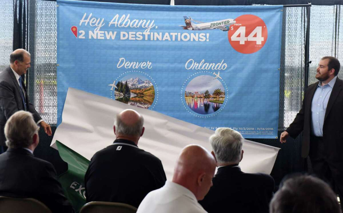 John O'Donnell, Albany International Airport CEO, left, and Seth Neuschwander, director of planning and revenue analysis for Frontier Airlines, right, announce Frontier Airlines' new service to Orlando and Denver from Albany International Airport on Tuesday, June 19, 2018, in Colonie, N.Y. Frontier Airlines will begin its direct service to Denver starting in September, and follow with Orlando flights in October. (Will Waldron/Times Union)