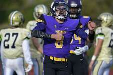 """Westhill quarterback AJ Laccona celebrates following a touchdown against Trumbull by teammate Angelo Nicholas during a game on Nov. 4 in Stamford. Laccona is one of three players on the team to win a $5,000 scholarship from Dallas Cowboys head coach Jason Garrett's Starfish Charities """"Make a Difference Challenge"""" contest."""