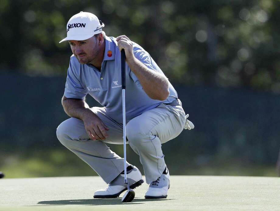 Graeme McDowell of Northern Ireland lines up a putt on the first green during the first round of the U.S. Open Golf Championship on Thursday in Southampton, N.Y. Photo: Julio Cortez / Associated Press / Copyright 2018 The Associated Press. All rights reserved.