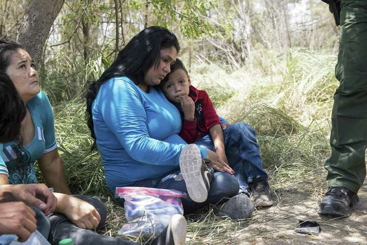 Keilyn Enamorada Matute, from Honduras, with her 4-year old son, as they surrender themselves to Border Patrol agents after crossing the Rio Grande from Mexico to the United States, in McAllen, Texas, June 8. The Trump administration said on June 15, that it had separated 1,995 children from parents facing criminal prosecution for unlawfully crossing the border over a six-week period that ended last month.