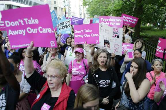 Supporters of Planned Parenthood at a rally May 24 in New York. The Trump Administration is proposing changes to Title X funding that the health-care provider for women contends amounts to a gag rule on abortion and will restrict the organization's ability to give complete care.