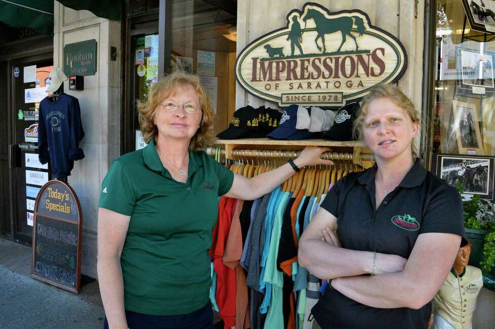 Marianne Barker, left, and Maddy Zanetti outside their Impressions of Saratoga store on Broadway Tuesday June 19, 2018 in Saratoga Springs, NY. (John Carl D'Annibale/Times Union)