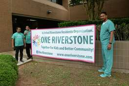 Riverstone residents demonstrate against rezoning at the Fort Bend ISD Administration Building, Sugar Land, TX on Monday, June 18, 2018.
