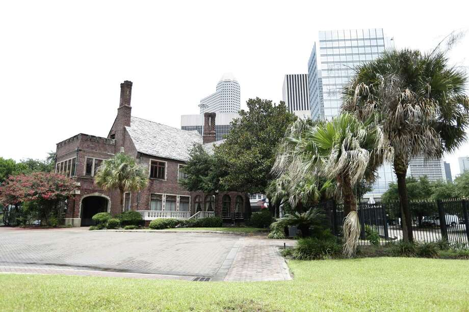 Exterior of the Kirby Mansion at 2000 Smith St, photographed, , Tuesday, June 19, 2018, in Houston. The future of the Kirby Mansion, a 1920s-era estate on the cusp of Midtown and downtown, is in peril as buyers are looking to purchase the historic property. The two-story English manor is owned by a lawyer with offices in the building.  ( Karen Warren  / Houston Chronicle ) Photo: Karen Warren, Staff / Houston Chronicle / © 2018 Houston Chronicle