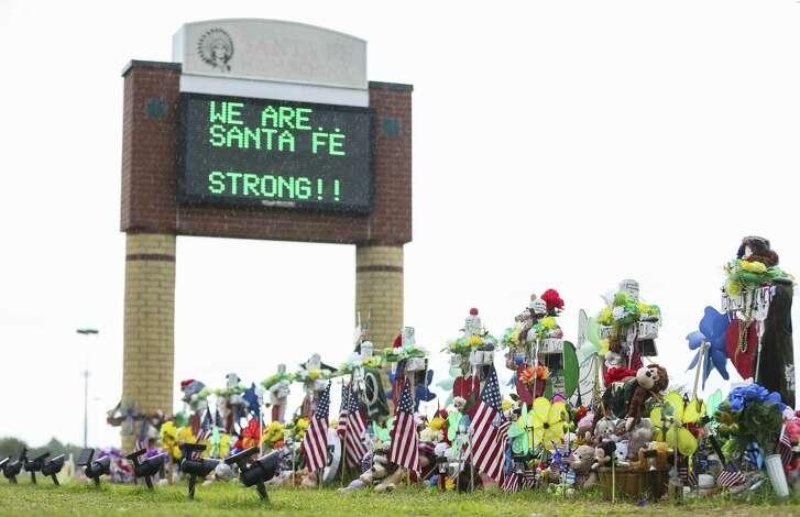 The memorial in front of Santa Fe High School along Highway 6, Monday, June 18, 2018 in Santa Fe. ( Mark Mulligan / Houston Chronicle )