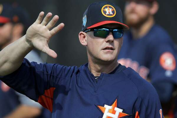 FILE - In this Feb. 15, 2018, file photo, Houston Astros manager A.J. Hinch waves during baseball spring training in West Palm Beach, Fla. Hinch believes the Astros have the right mindset for continued success this season. (AP Photo/Jeff Roberson, File)