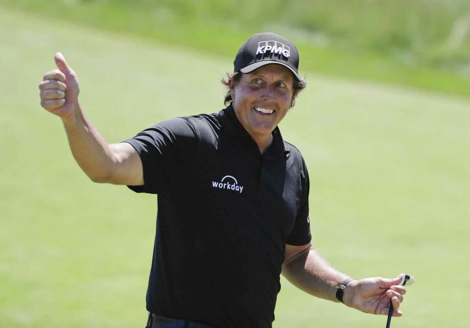 Phil Mickelson reacts after sinking a putt on the 13th hole during the final round of the U.S. Open Championship on Sunday in Southampton, N.Y. Photo: Frank Franklin II / Associated Press / Copyright 2018 The Associated Press. All rights reserved.