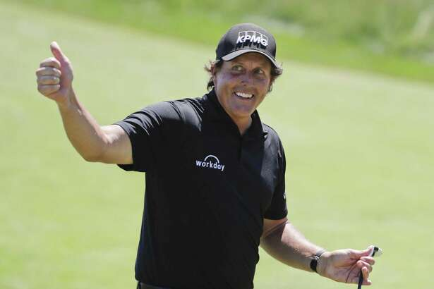 Phil Mickelson reacts after sinking a putt on the 13th hole during the final round of the U.S. Open Championship on Sunday in Southampton, N.Y.