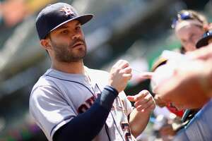OAKLAND, CA - JUNE 14:  Jose Altuve #27 of the Houston Astros signs autographs before their game against the Oakland Athletics at Oakland Alameda Coliseum on June 14, 2018 in Oakland, California.  (Photo by Ezra Shaw/Getty Images)