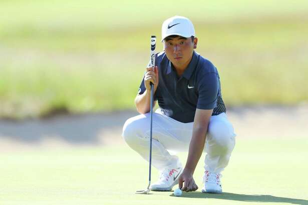 Amateur Doug Ghim lines up a putt on the third hole during the first round of the U.S. Open at Shinnecock Hills Golf Club on Thursday.