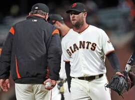 San Francisco Giants' Hunter Strickland is removed from the game by manager Bruce Bochy after giving up 3 runs and a 4-2 lead in 9th inning against Miami Marlins during MLB game at AT&T Park in San Francisco, Calif. on Monday, June18, 2018.