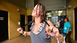 Bryanna Wilburn rubs an ice-soaked neck cooler around her neck and shoulders while at the courtyard at Haven For Hope this May. Newly released data from the Associated Press and the National Weather Service show that local temperatures have already increased by an average of just over 1 degree Fahrenheit in the last 30 years compared with the average temperature of the first 60 years of the 20th century.