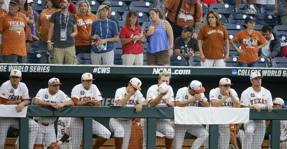 Texas players stand in the the dugout during the ninth inning of an NCAA College World Series baseball elimination game against Florida in Omaha, Neb., Tuesday, June 19, 2018. Florida won 6-1. (AP Photo/Nati Harnik) Photo: Nati Harnik/Associated Press