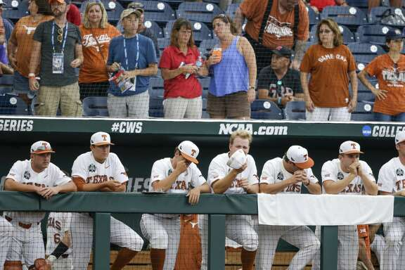 Texas players stand in the the dugout during the ninth inning of an NCAA College World Series baseball elimination game against Florida in Omaha, Neb., Tuesday, June 19, 2018. Florida won 6-1. (AP Photo/Nati Harnik)