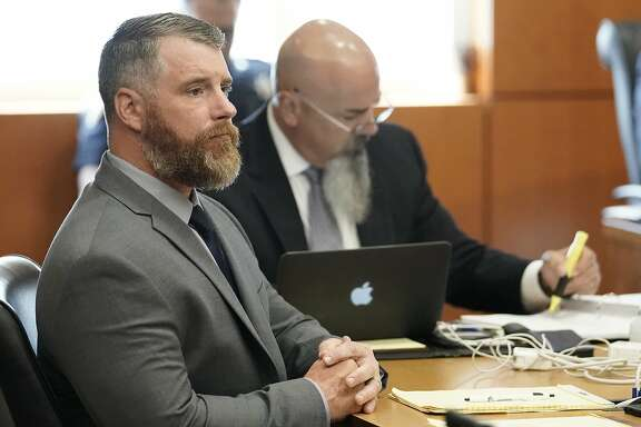 Terry Thompson, accused of fatally choking John Hernandez, left, is shown in court with his attorney Greg Cagle, right, Wednesday, June 13, 2018 in Houston. Terry and his wife Chauna Thompson, a former Harris County Sheriff's deputy, are charged with murder in the chokehold death of John Hernandez at a Denny's. ( Melissa Phillip / Houston Chronicle )