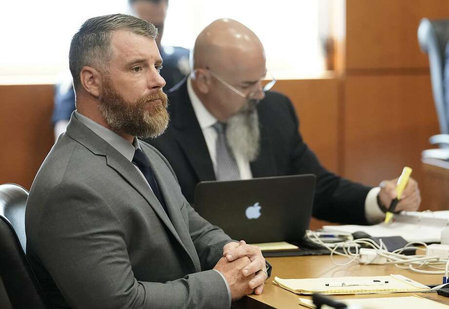 Terry Thompson, accused of fatally choking John Hernandez, left, is shown in court with his attorney Greg Cagle, right, Wednesday, June 13, 2018 in Houston. Terry and his wife Chauna Thompson, a former Harris County Sheriff's deputy, are charged with murder in the chokehold death of John Hernandez at a Denny's. ( Melissa Phillip / Houston Chronicle ) Photo: Melissa Phillip, Houston Chronicle