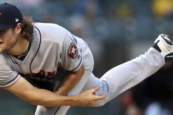 FILE - In this June 13, 2018, file photo, Houston Astros pitcher Gerrit Cole follows through on a delivery to an Oakland Athletics batter during the first inning of a baseball game in Oakland, Calif. Cole, Corey Kluber and Clayton Kershaw are among the many big league pitchers maximizing success by throwing fewer fastballs. (AP Photo/Ben Margot, File)
