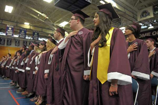 The class of 2018 stands for the playing of the National Anthem at the start of the Bethel High School 2018 Graduation, Tuesday night, June 19, 2018, at the Western Connecticut State University O'Neill Center, Danbury, Conn.