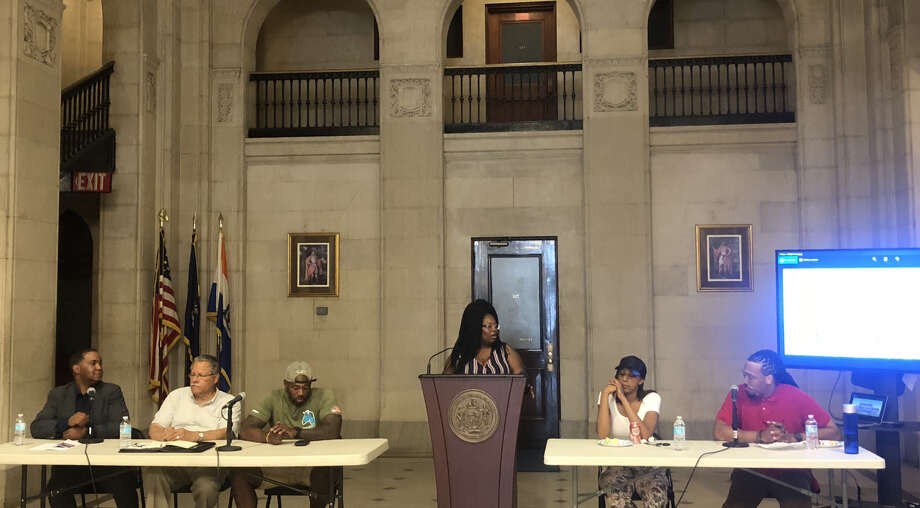 (From left to right) Tony Gaddy, Paul Stewart, Brandon Gibson, Eva Bass, Keteesh Thomas and DeSean Moore discuss the importance and success of MWBEs in Albany in City Hall on June 19, 2018. (Times Union)