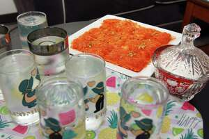 Kanafeh, which is a Middle Eastern dessert, is served by Zainab Al-Qaderi, a refugee chef from Iraq, at her home in New Haven on Tuesday. Al-Qaderi will serve the dessert on Saturday at the World Refugee Day Festival.