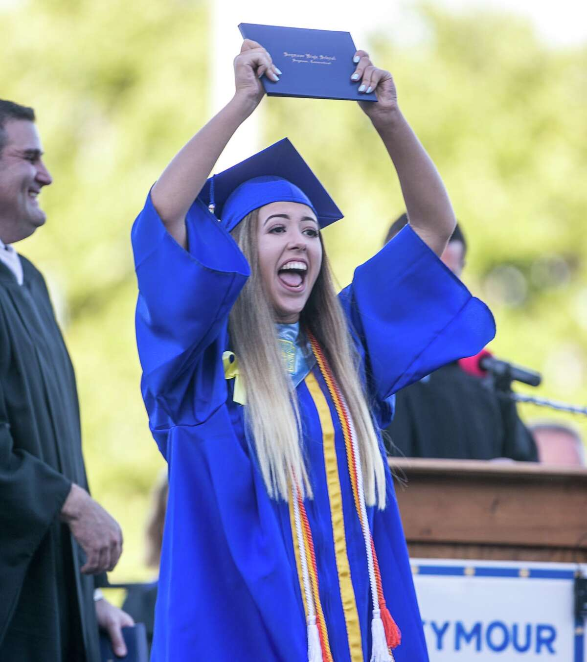 (John Vanacore/For Hearst Connecticut Media) Seymour High School graduate Victoria Palumbo celebrates after receiving her diploma Tuesday evening.