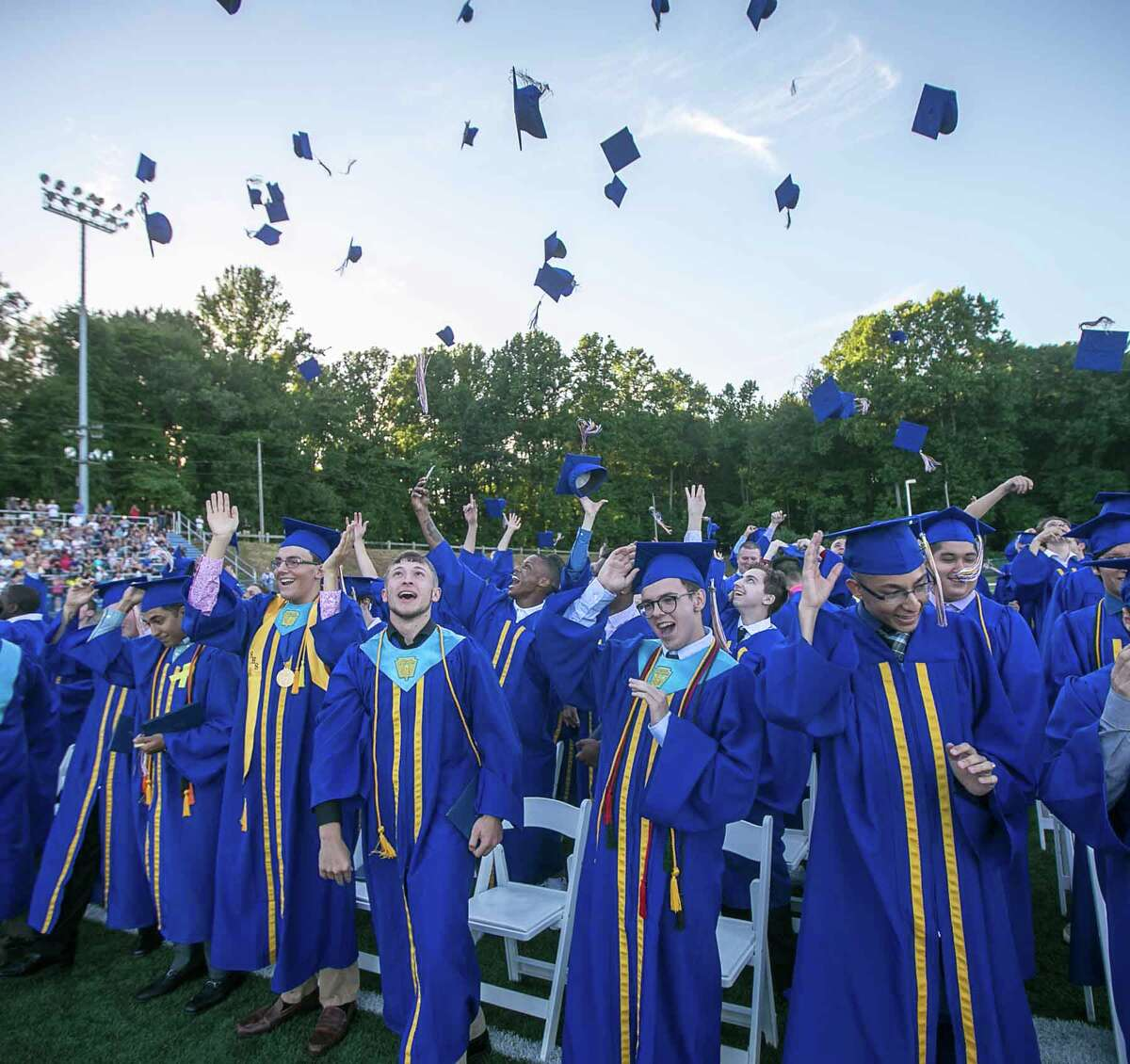 (John Vanacore/For Hearst Connecticut Media) Seymour High School Graduates toss their caps in the air in celebration at the conclusion of commencement exercises Tueday evening.