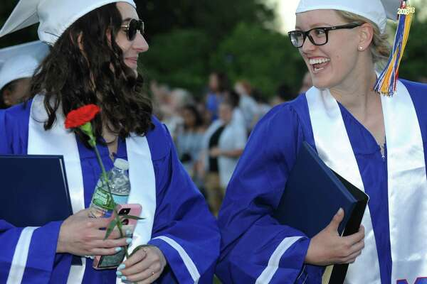 Seniors celebrate the graduation of the Class of 2018 during the Brien McMahon commencement exercises Tuesday, June 19, 2018, in Norwalk, Conn