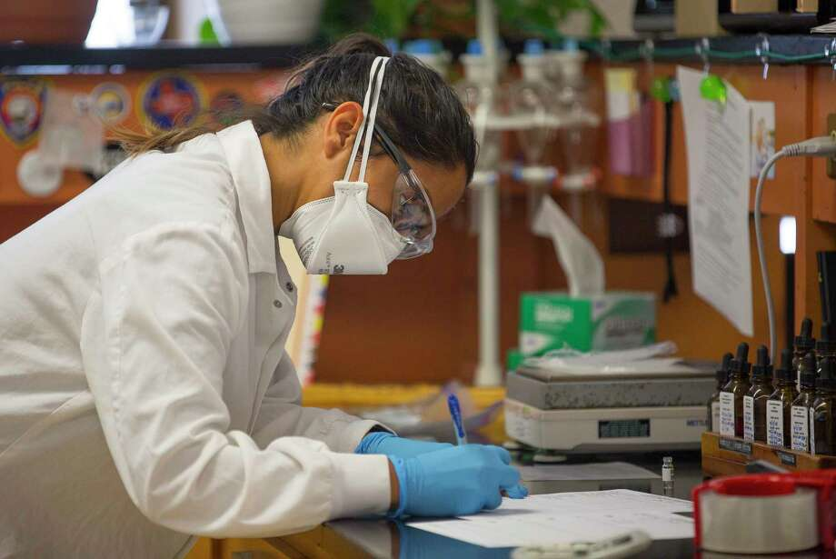PHOTOS: Forensics workThe Houston Forensic Science Center plans to move out of the Houston Police Department headquarters to a new building downtown, the crime lab announced Monday. >>See what the science center team does, from crime analysis to testing balistics Photo: Mark Mulligan, Houston Chronicle / © 2018 Houston Chronicle
