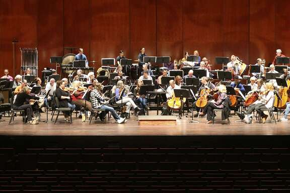 The San Antonio Symphony, shown rehearsing in January for a Tricentennial concert, has undergone decades of financial problems. A task force formed by Mayor Ron Nirenberg and County Judge Nelson Wolff has come up with a strategic plan to address those problems.