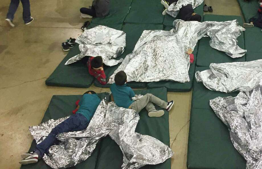 FILE - In this Sunday, June 17, 2018, file photo provided by U.S. Customs and Border Protection, people who've been taken into custody related to cases of illegal entry into the United States, rest in one of the cages at a facility in McAllen, Texas. Child welfare agencies across America make wrenching decisions every day to separate children from their parents. But those agencies have ways of minimizing the trauma that aren't being employed by the Trump administration at the Mexican border. (U.S. Customs and Border Protection's Rio Grande Valley Sector via AP, File) / US BORDER PATROL