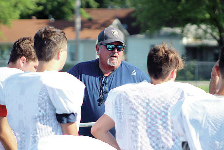 Jersey football coach Ric Johns speaks with players during a summer workout session Tuesday morning at the Snyders sports Complex in Jerseyville. Johns, a longtime area coach at Calhoun, Triad, Belleville West and Wesclin, is beginning his first year at Jersey. Photo:       Pete Hayes | The Telegraph