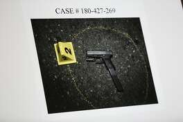 The weapon retrieved at the scene from an officer-involved shooting is seen during a town hall meeting at the Cathay Post No. 384, Thursday, June 14, 2018, in San Francisco, Calif. Police officials described the scene of an officer-involved shooting. On June 9, police said Oliver Barcenas, 28, drew a firearm from his waist as he fled police. The pursuing officer discharged his firearm and struck Barcenas, who was taken into custody and remains in the hospital recovering from his injury.