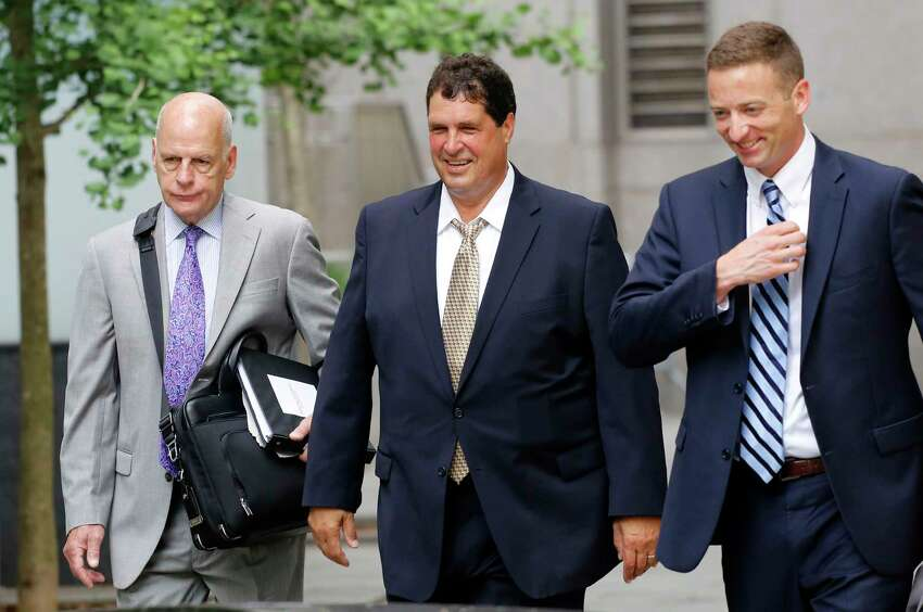 Steven Aiello, center, arrives at federal court for his corruption trial, Tuesday, June 19, 2018, in New York. (AP Photo/Mark Lennihan)