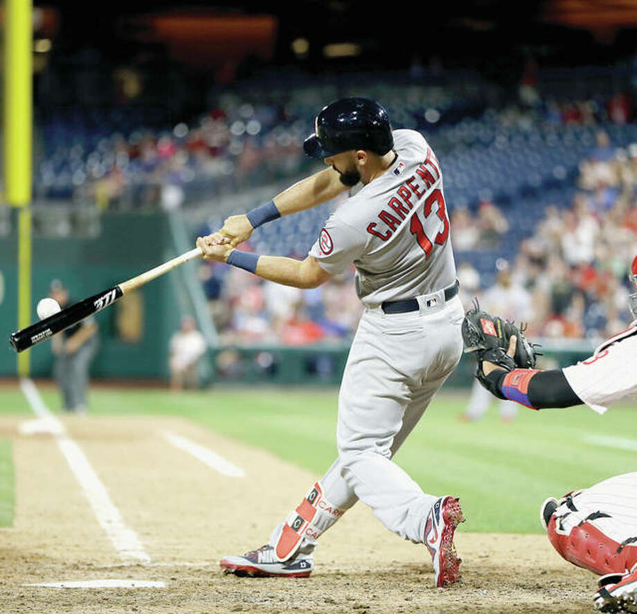 The Cardinals' Matt Carpenter hits the go-ahead home run off Phillies relief pitcher Seranthony Dominguez in the ninth inning of Tuesday night's game in Philadelphia. Photo:       AP