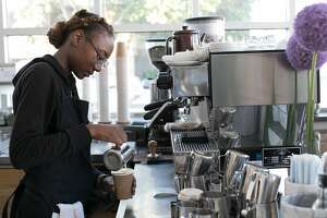 Marurica Clark makes a drink at Blue Bottle Coffee in Oakland, Calif.