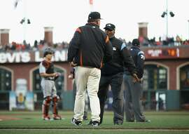 SAN FRANCISCO, CA - JUNE 19:  Manager Bruce Bochy of the San Francisco Giants argues with umpire Laz Diaz after Dan Straily #58 of the Miami Marlins hit Buster Posey #28 of the San Francisco Giants in the second inning at AT&T Park on June 19, 2018 in San Francisco, California.  (Photo by Ezra Shaw/Getty Images)