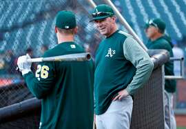 Oakland Athletics' manager Bob Melvin chats with Matt Chapman before the A's play San Francisco Giants during Bay Bridge Series game at AT&T Park in San Francisco, Calif., on Monday, March 26, 2018.