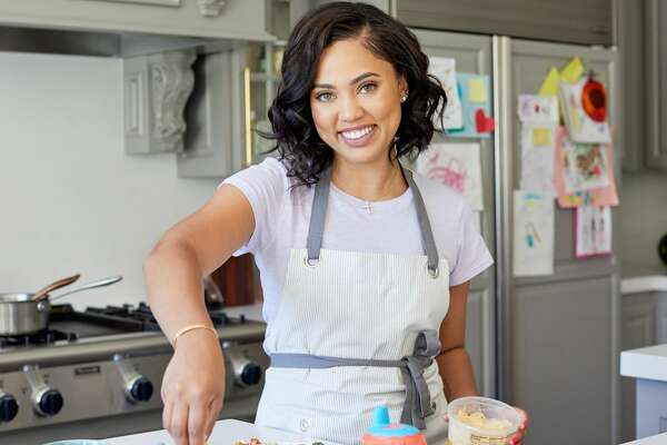 Lifestyle expert and cookbook author Ayesha Curry is partnering with James Beard Award-winning chef Michael Mina to open International Smoke restaurant in Houston in July 2018.