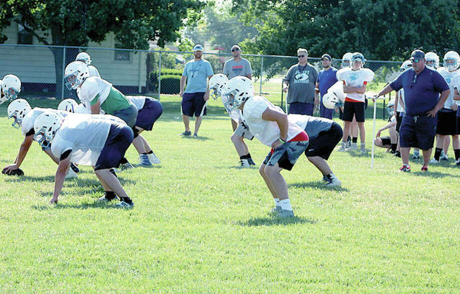 Jersey football coach Ric Johns, far right, watches his team go through drills during a summer workout session Tuesday at the Snyders Sports Complex in Jerseyville. Photo:       Pete Hayes | The Telegraph