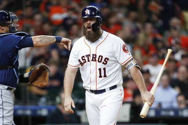 Houston Astros catcher Evan Gattis (11) reacts after striking out against the Tampa Bay Rays during the fourth inning of a major league baseball game at Minute Maid Park on Tuesday, June 19, 2018, in Houston. ( Brett Coomer / Houston Chronicle )