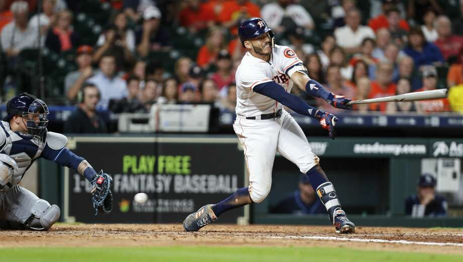 Houston Astros shortstop Carlos Correa (1) strikes out during the eighth inning of a major league baseball game against the Tampa Bay Rays at Minute Maid Park on Tuesday, June 19, 2018, in Houston. ( Brett Coomer / Houston Chronicle ) Photo: Brett Coomer/Houston Chronicle
