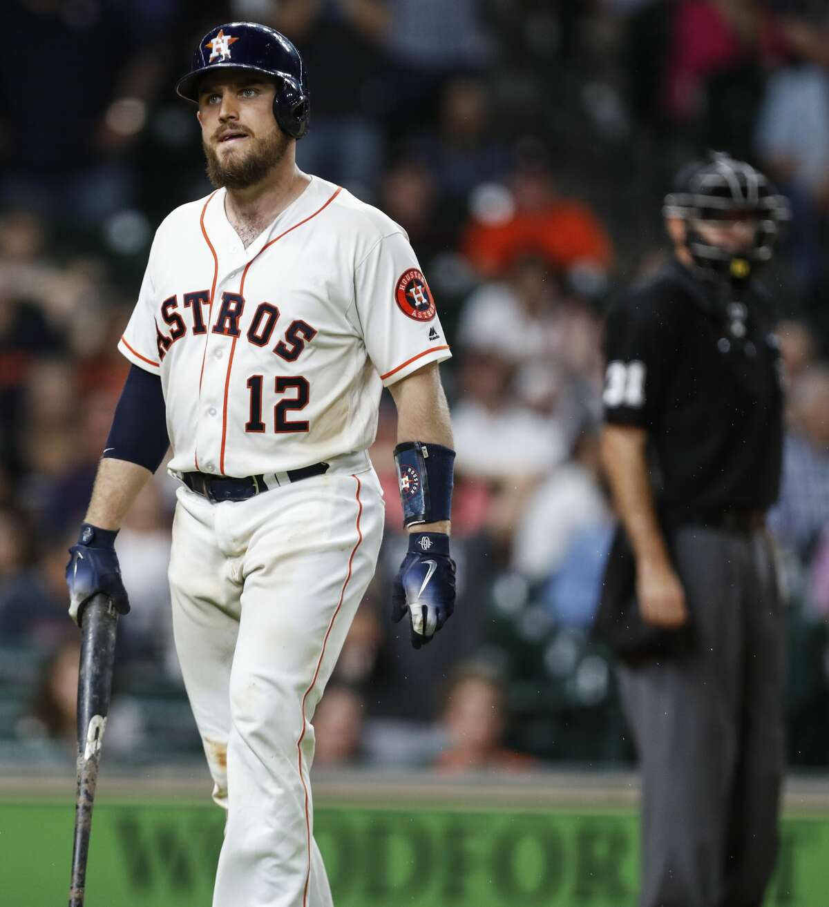 Houston Astros catcher Max Stassi (12) walks off the field after striking out against the Tampa Bay Rays during the ninth inning of a major league baseball game at Minute Maid Park on Tuesday, June 19, 2018, in Houston. ( Brett Coomer / Houston Chronicle )