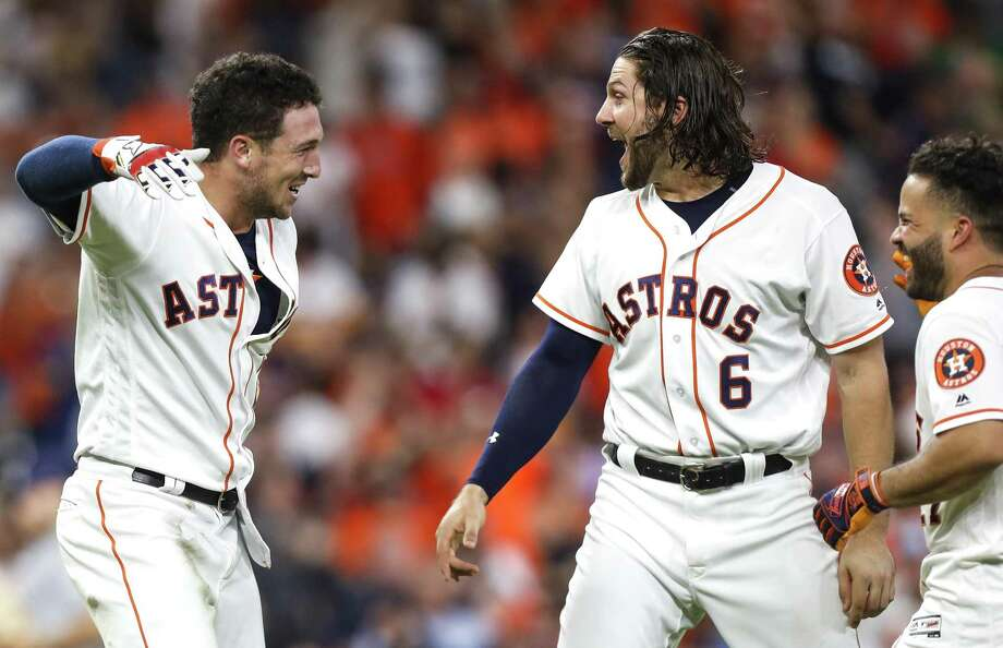The highlight of the Astros' winning streak may have been a walk-off hit by Alex Bregman, left, that excited Jake Marisnick. Photo: Brett Coomer, Staff / Houston Chronicle / © 2018 Houston Chronicle