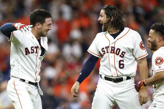 The highlight of the Astros' winning streak may have been a walk-off hit by Alex Bregman, left, that excited Jake Marisnick.