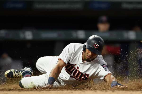 MINNEAPOLIS, MN - JUNE 19: Eddie Rosario #20 of the Minnesota Twins slides safely into home plate against the Boston Red Sox during the sixth inning of the game on June 19, 2018 at Target Field in Minneapolis, Minnesota. (Photo by Hannah Foslien/Getty Images)